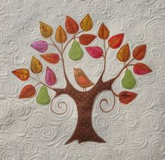 First Day of Christmas Tree - no pattern, but more pictures on In Stitches of Williamsburg at http://laurainstitches.typepad.com/in_stitches_of_williamsto/2010/08/craft-and-quilt-show-favourites.html