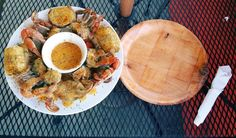 Garlic blue crabs is a classic low-country soul food dish, found in coastal areas. The crabs are served with a garlic butter sauce and corn on the cob and potatoes as seen here at STM Seafood of Gainesville. (Photo by Mike Walker)