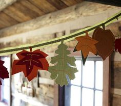 Leaf Garland from Pottery Barn, sells for $49.      Soft felt leaves in yellows, greens and reds add a warm tone to a holiday setting.  9' long  Crafted of polyester felt and printed fabric leaves and sewn onto a grosgrain ribbon.  Features two loops for easy hanging.  Imported.