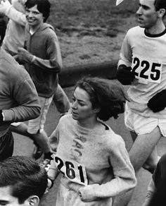 Two young women race elbow to elbow with approximately 600 men in Boston A.A. Marathon in Hopkinton, Mass., April 19, 1967. Officials tried to pull the women out of the start line but were stopped by a protective cordon of men. (AP Photo)