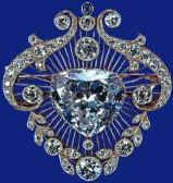 Among the jewelry pieces that belonged to the queen's grandmother Queen Mary is the Cullinan V Heart Brooch, which has the fifth largest stone from the Cullinan cleavings (18.8 carats) at its center. Beautiful.