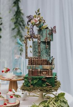 """Whimsical is an adjective that means """"intricate, not ordinary."""" It looks like the perfect word to describe a wedding unlike any other! Whimsical Wedding Cakes, Floral Wedding Cakes, Wedding Cake Designs, Wedding Cupcakes, Wedding Themes, Our Wedding, Wedding Decorations, Green Wedding Cakes, Castle Wedding Cake"""