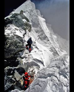 feet above sea level; Anatoli Boukreev climbing the Hillary Step, belayed by Neal Beidleman, as a fierce wind rakes the summit ridge of Mt. Monte Everest, Climbing Everest, Climbing Outfits, Mountain Climbing, Ice Climbing, Winter Camping, Sea Level, Top Of The World, Extreme Sports