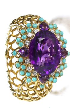 Diamond, amethyst and turquoise bracelet , David Webb the bracelet with central, detachable brooch-pendant featuring an oval-shaped amethyst, within a surround of round brilliant-cut diamonds, heart-shaped amethyst and cabochon turquoise completed by a openwork textured bangle.