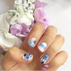 Who knew a Winnie the Pooh character could be so cute on your nails? The pastel shades keep this Disney nail art design are sweet, while the alternating patterns give it a touch of sophistication.