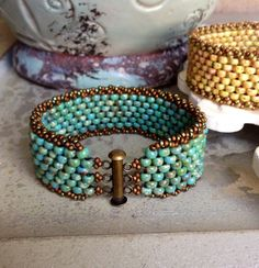 ~ Turquoise Chic Cuff ~  Wear alone or with your favorite bracelets or watch. These peyote cuffs will complete your look AND feel fabulous on! Extremely comfortable...youll love it!  Just under one inch thick of forever-in-style turquoise-colored beads sprinkled with dashes of color that make a statement all on its own. Attached is a complementing trim for a finished look. Six rows of beads individually sewn together one-by-one with 10-pound fire line... Very Sturdy!  ~This listing is for…