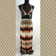"MADIGO MAXI ANIMAL PRINT MAXI Brown animal print maxi with halter tie. 100% Poly.  Length of skirt 41"". Elastic waist.   Silky knit feel material. One size. Typicalky size 8/10 fit best. Madigo Dresses Maxi"