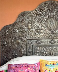 Gorgeous metal headboard that adds shine, interest and surprise to a master bedroom.