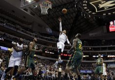 Dallas Mavericks' Monta Ellis (11) goes up for a shot over Utah Jazz's Derrick Favors (15) and Marvin Williams (2) as the Mavericks' DeJuan Blair, left, and the Jazz' John Lucas III, right, watch in the first half of an NBA basketball game, Friday, Feb. 7, 2014, in Dallas. (AP Photo/Tony Gutierrez)