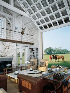 woa there inside outside blending quite a surreal vista with the scale of the room looking out to the paddocks beyond.. almost like viewing a painting of the horse and  paddocks.