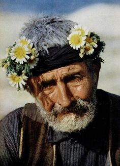 Old man from Yemen.  The Flowered Men are one of the tribes living in the border area between Saudi Arabia and Yemen, around the city of Al Farshan. The men wear a typical headdress which is a collar made of flowers and grasses.