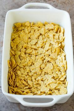 This taco casserole is layers of tortilla chips, refried beans and beef, all topped with plenty of cheese and baked to perfection. Taco Casserole With Tortillas, Easy Taco Casserole, Chicken Enchilada Casserole, Mexican Casserole, Casserole Dishes, Casserole Recipes, Noodle Casserole, Recipe Using Tortillas, Baked Tacos Recipe