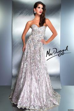 Mac Duggal Style 78724D - The richly detailed design of this ravishing A-line gown will blow your mind! Floral patterns are embroidered all across this sublime dress, whose bodice fits closely and is topped off by a simple sweetheart strapless neckline with shimmering edging. Glittering stones are sprinkled across this strapless dress and run across its flared, floor-length skirt. Completely constructed of rhinestone covered lace with a scalloped hem on the bottom of the skirt. A satin slip…