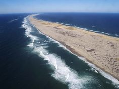 Sable Island, 300 km south-east of Halifax, Nova Scotia, Canada, is renowned for its wild horses and often referred to as the Graveyard of the Atlantic.  http://en.wikipedia.org/wiki/Sable_Island