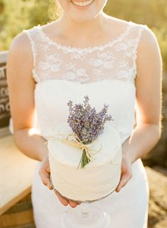 Lavendar Wedding Cake- For a change, incorporate your wedding colours in the form fresh flowers (like this bride did with lavender) on top of a simple wedding cake.