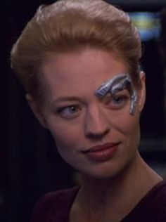 Seven of Nine (full Borg designation: Seven of Nine, Tertiary Adjunct of Unimatrix 01) was a Human female who was a former Borg drone. She was born Annika Hansen on stardate 25479 (2350), the daughter of eccentric exobiologists Magnus and Erin Hansen. She was assimilated by the Borg in 2356 at age six, along with her parents, but was liberated by the crew of the USS Voyager in 2374. She joined the crew and returned to the Alpha Quadrant with the starship in 2378. Played by Jeri Ryan