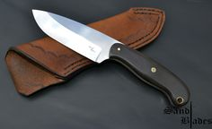 N690 Satin finished Hollow ground Tapered tang Red formica liners African Blackwood scales Brass pin, lanyard tube and mosaic  OAL 214mm Blade length 105mm  Handmade cowhide sheath (two-tone brown)  To order your custom blade, Please contact me  079 499 7191 sandtcustomblades@gmail.com  Follow me on Facebook  @SandtCustomBlades