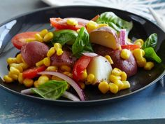 Potato, Tomato, Corn and Basil Salad: This delicious salad uses simple seasonal ingredients, which will save you money. Try it for your next outdoor cookout.