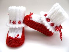 Knitted Baby Booties Fit (on average) 4-12 months Sparkly Ruby Red Slipper Booties made to look like a red pump style shoe. Red yarn is acrylic and has sparkles throughout the yarn. White acrylic yarn for ribbed anklet socks with scalloped edging. Tan acrylic yarn for sole of shoe. Red with white polka dots grosgrain ribbon through eyelets of socks, tied in back. Red with white polka dots satin decorative bow on front of shoe. (There is no strap on the shoe because it is a pump shoe). Al...