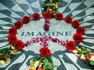 """Strawberry Fields is a 2.5-acre (10,000 m2) landscaped section in New York City's Central Park that is dedicated to the memory of the musician John Lennon. It is named after The Beatles song """"Strawberry Fields Forever""""."""