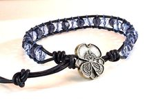Hey, I found this really awesome Etsy listing at https://www.etsy.com/listing/188262470/blue-bracelet-leather-cord-wrap-crystals