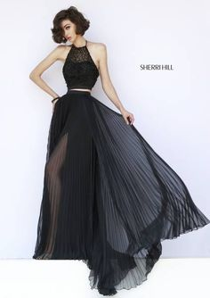 SHERRI HILL Prom Dresses 2015 # 32109 Elegant two piece shimmers with black beading on the crop top with halter neckline and low back. Sheer pleated full length skirt exposes a surprise high slit on the lining.