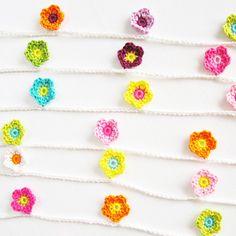 Crochet Flower Garland Pattern & Tutorial. Crochet Flower Garland Tutorial – a colorful and flowery mini garland that will uplift one's spirit.