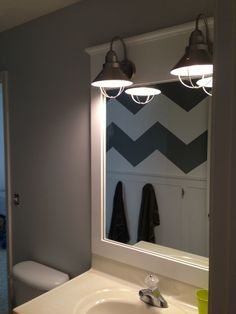 Chevron bathroom finally complete! Board and batten with boat cleats to hang towels on!