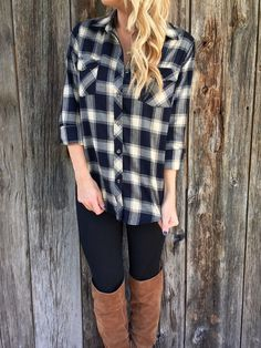 "A thick checkered plaid top with a button up front and two pockets. Long sleeves. Unlined. *Top is a very dark navy, almost black. 100% Rayon 27"" length from shoulder to hem Measured from size small, laid flat Hand wash cold Model Stats: Height: 5""7, Bust: 34, Waist: 26, Hip: 36 