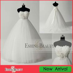 1.tulle skirt feather dress real picture ball gown wedding dress2.No MOQ and fast delievey3.%100 quality