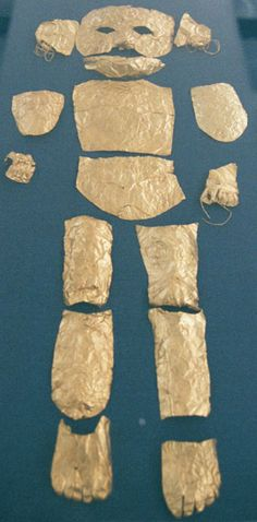 """Gold pieces covering a child's body found in a tomb in Mycenae. The royal tombs on Mycenae yielded so many gold objects that Homer's description of it as """"the city rich in gold"""" cannot be doubted. 