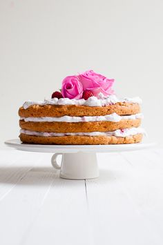 Delicious vegan layer cake is filled with coconut whipped cream, vanilla and raspberries. It is also gluten and refined sugar free.