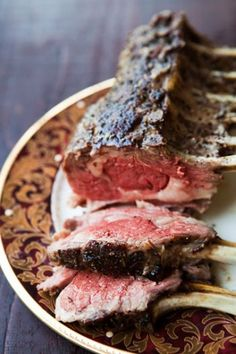 Tender oven-roasted rack of lamb, seasoned with rosemary, thyme, garlic, salt and freshly ground black pepper, and slathered with olive oil. ~ SimplyRecipes.com