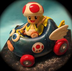 Toad Mario Kart Cake - hmm, I think I am getting ideas . Mario Kart Cake, Mario Kart Ds, Big Cakes, Fancy Cakes, Cupcakes, Cupcake Cakes, Wii Characters, Fondant Figures Tutorial, Mario Party