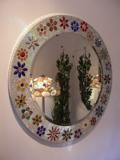 Round - hand-crafted mirror with flower theme. Inlay with gemstones and Gablonz crystals.  www.gemoholic.com
