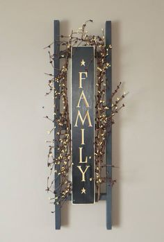 .ladder with family sign