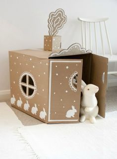 DIY Cardboard Playhouse - cute storage for toys Cardboard Houses For Kids, Cardboard Playhouse, Cardboard Furniture, Cardboard Crafts, Paper Crafts, Cardboard Castle, Kids Crafts, Craft Kids, Carton Diy