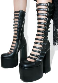 Current Mood Transaction Boots cuz nothin' comes free when yer dealin' with me~ These supa hott boots feature a smooth black vegan leather construction, chunky platform 'N curved block heel, thin adjustable buckles runnin' up yer calves, and inner zip closures for a sleek fit.