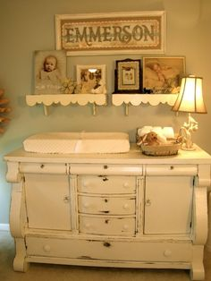 love that old dresser, repurposed into a changing table :)