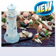 Small World Play Coastal Discovery Scene Kit - children can create their own coastline with shells, a lighthouse and shipwrecks.