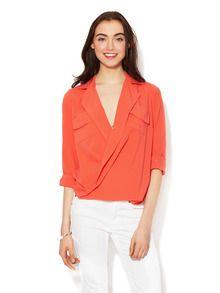tangerine shirt. casual style.