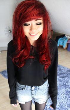 Dyed, red hair. Smokey eye makeup.