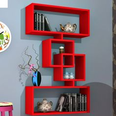 Wall shelves are simple and ingenious storage solutions for things like books, decorations, personal collections and other small objects Cube Wall Shelf, Unique Wall Shelves, Cube Shelves, Floating Wall Shelves, Wall Shelves Design, Cube Bookcase, Red Wall Decor, Diy Room Decor, Empty Wall Spaces