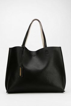 Reversible Vegan Leather Oversized Tote Bag - Urban Outfitters. Black reverses to cream...2 bags in 1!