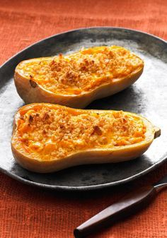 Cheesy Stuffed Butternut Squash -- In this tasty recipe, the natural creaminess of roasted butternut squash gets an additional boost from cheddar cheese, sour cream and a buttery crushed cracker topping.
