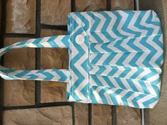 "This aqua chevron ""Abigail"" is perfect for spring! Features 4 inside slip pockets, magnetic snap and decorative  button on the outside front. $48 visit www.myahbags.com"