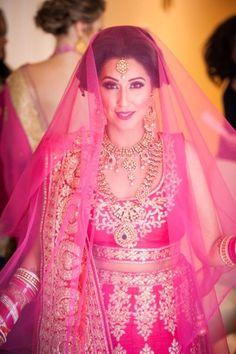 Looking for Bride in bright pink lehenga with dupatta as veil? Browse of latest bridal photos, lehenga & jewelry designs, decor ideas, etc. on WedMeGood Gallery. Indian Lehenga, Gold Lehenga, Bridal Lehenga, Desi Wedding, Wedding Attire, Wedding Bride, Indian Bridal Wear, Bride Indian, Indian Weddings