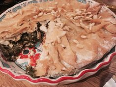 Filo pie stuffed with kale, feta, peppers and pine nuts. Delicious flavours and full of goodness