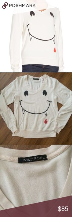 Wildfox Vampire Smiley Jumper Super soft and cozy V neck jumper.  Cream with vampire smiley graphic size Xs  in great preowned condition! no trades Wildfox Tops Sweatshirts & Hoodies