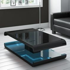 HIGH GLOSS BLACK Coffee Table with LED Lighting - Tiffany Range TIFF010 - £229.97. FOR SALE! Our Feedback Other Listings Contact us About us High Gloss Black Coffee Table with LED Lighting - Tiffany Range TIFF010 Ask A Question Other Items Item Description A bold and instant injection of style to your room. This unique coffee table can create beautiful ambiance and will be real focal 162353332958 Coffee Table High Gloss, Black Coffee Tables, Unique Coffee Table, Low Shelves, Main Colors, The Help, Tiffany, Led, Contemporary